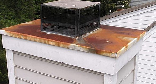 Chimney with rusted chase cover