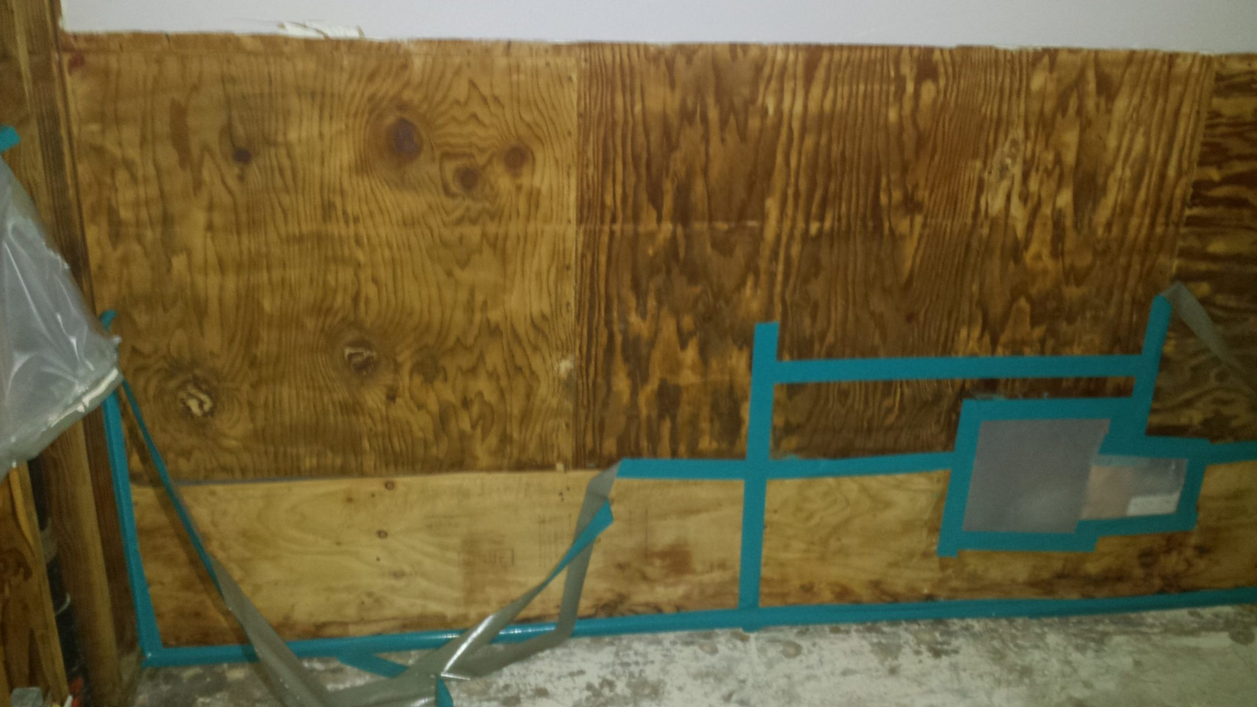 Taping the joints between sheets of plywood