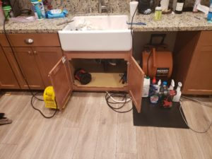 water damage under kitchen sink