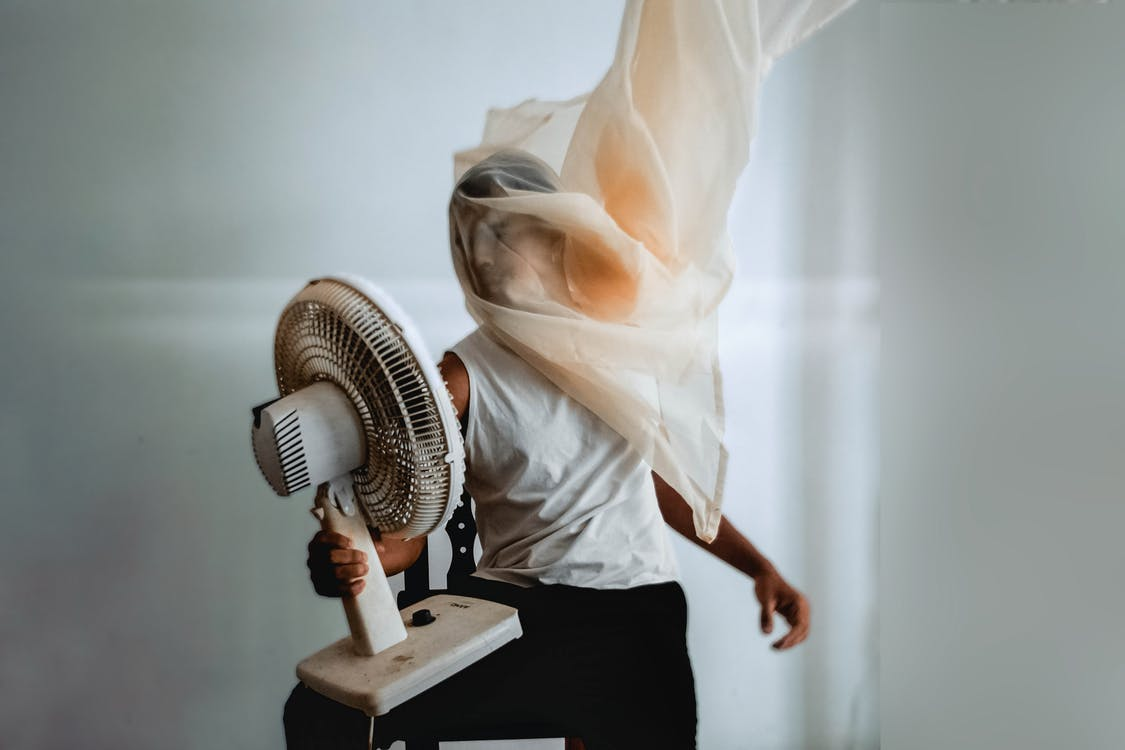 Photo Of Person Holding Electric Fan